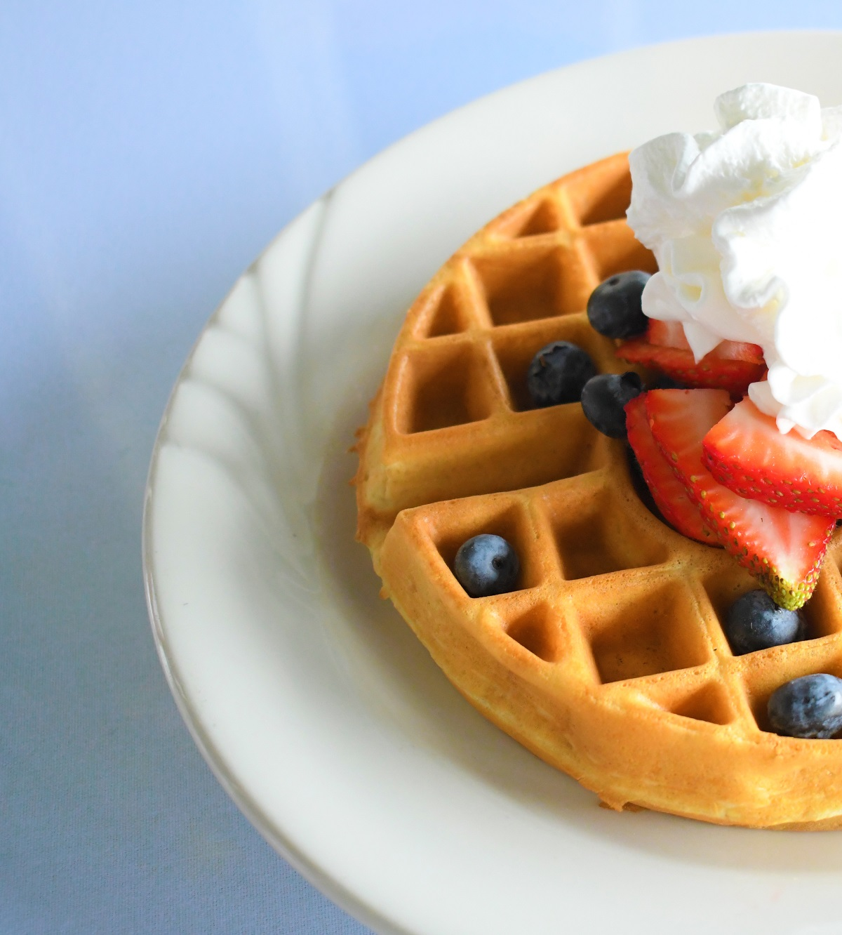 waffle with whipped cream and fruit on top